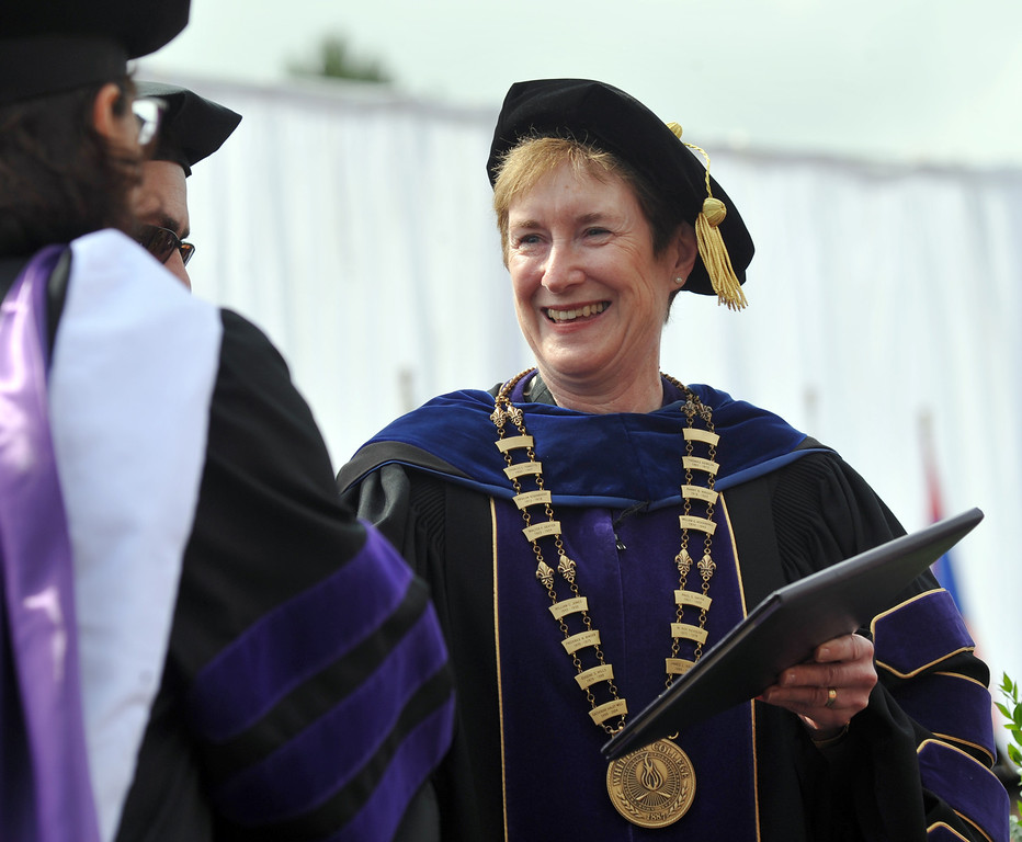 Description of . President Sharon Herzberger awards a diploma during the 110th Commencement Ceremony at Memorial Stadium on the Whittier College campus in Whittier on Friday May 17, 2013. Award-winning journalist Sonia Nazario gave the keynote address and received an honorary degree from the Whittier College faculty: a doctorate of humane letters.(SGVN/Staff Photo by Keith Durflinger)