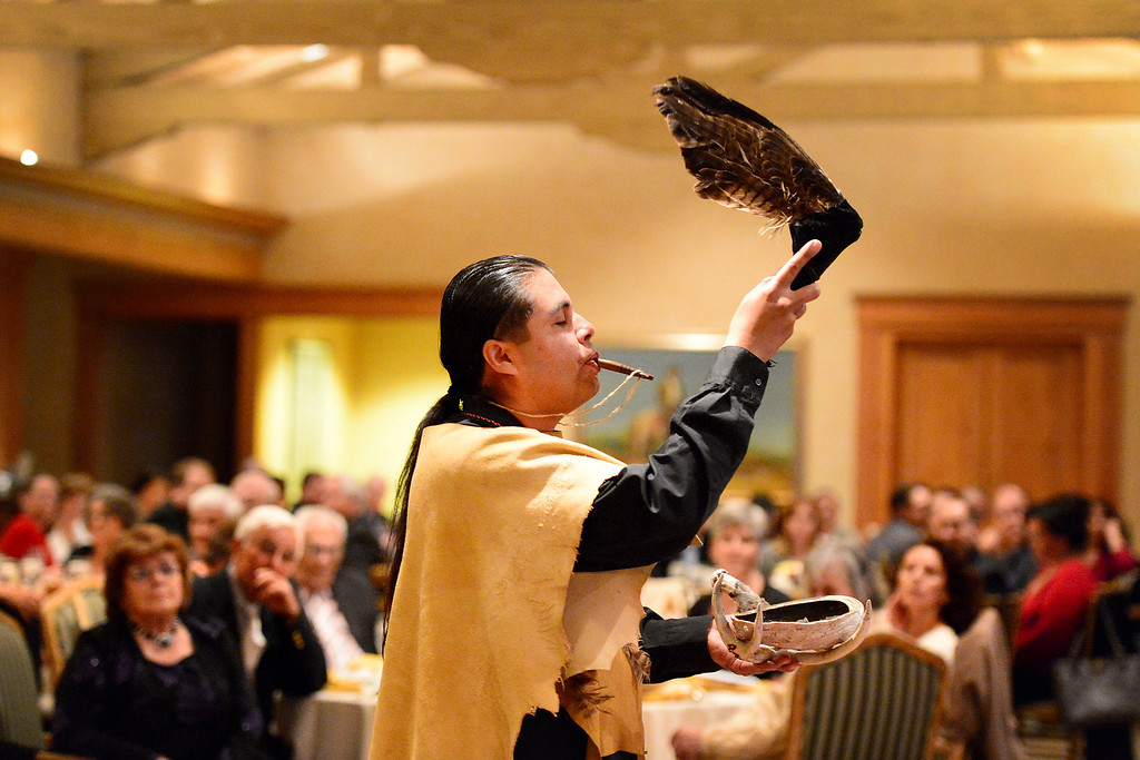 Description of . Andrew Morales, of the Gabrieleno Tongva, blesses the San Gabriel's Centennial Dinner April 24, 2013. Gabrielenos have been trying for decades to have their tribe be recognized by the Federal Government causing strain amongst tribal members. They are not alone in their quest to receive federal benefits through a process that many say is an impossible bureaucracy. (SGVN/Staff Photo by Sarah Reingewirtz)