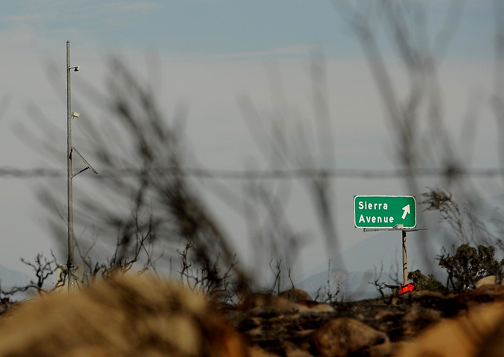 Description of . A view of land burned in Mondays fire along the I-15 freeway near Sierra Avenue exit in North Fontana May 14, 2013.  GABRIEL LUIS ACOSTA/STAFF PHOTOGRAPHER.