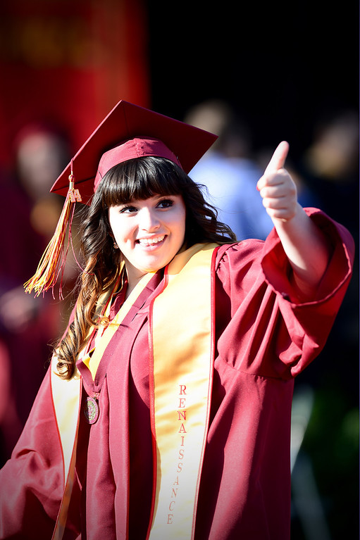Description of . Serena Alba, a district scholar, celebrates after receiving her diploma during Wilson High School's forty-seventh commencement ceremony Tuesday evening, May 20, 2014 at the Hacienda Heights school. (Photo by Sarah Reingewirtz/Pasadena Star-News)