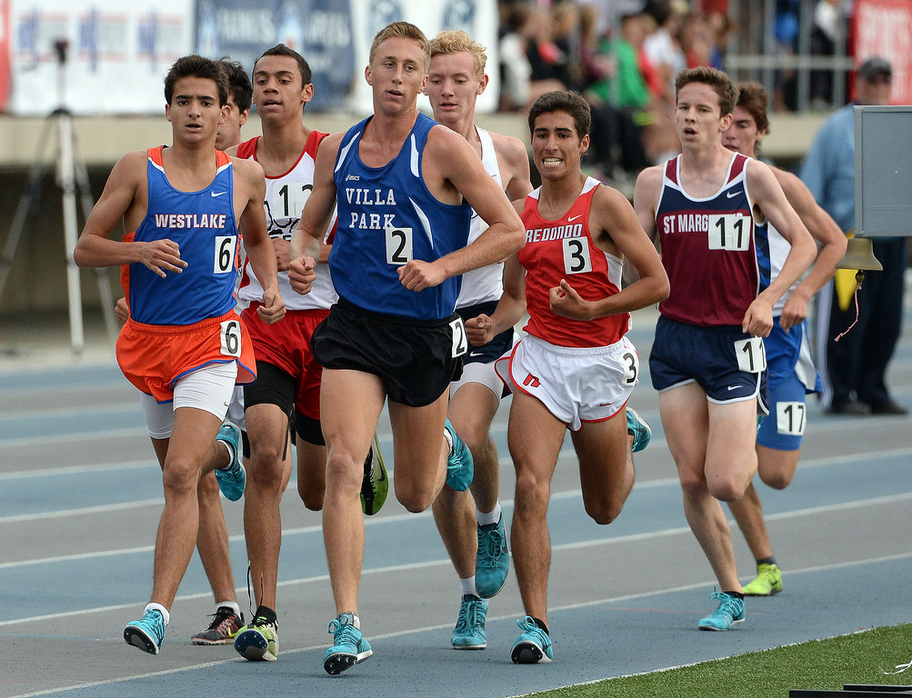 Description of . Westlake's Mikey Giguere, left, competes in the division 2 3200 meter run during the CIF Southern Section track and final Championships at Cerritos College in Norwalk, Calif., Saturday, May 24, 2014. 