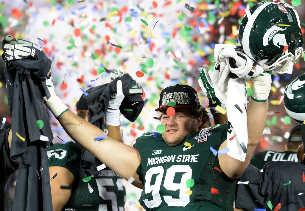 Description of . Michigan State's James Kittredge celebrates after defeating Stanford 24-20 during the 100th Rose bowl game in Pasadena, Calif., on Wednesday, Jan.1, 2014. 