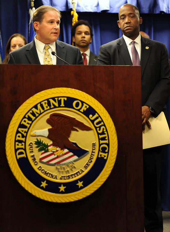 Description of . FBI Assistant Director in Charge Bill Lewis, left, speaks as U.S. Attorney André Birotte Jr. looks on during a Los Angeles press conference on Friday, Feb. 21, 2014, to announce charges against State Sen. Ron Calderon and his brother Tom that include mail fraud, money laundering, tax evasion, and fraud related to health care. (Photo by John McCoy/Los Angeles Daily News)