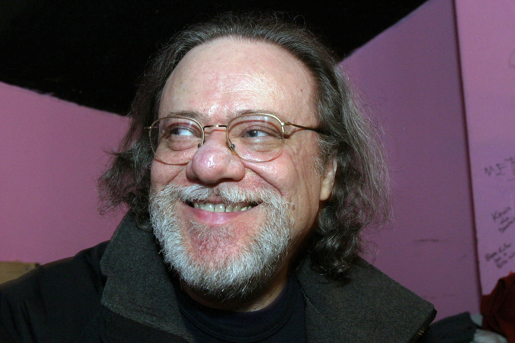 Description of . In this Jan. 8, 2005, file photo, Tommy Ramone, ex-drummer and manager of The Ramones, smiles as he is interviewed backstage at the Knitting Factory in New York. Ramone, co-founder of the seminal punk band The Ramones and the last surviving member of the original group, died on Friday, July 11, 2014. He was 65. http://bit.ly/1sDcJoS  (AP Photo/Tina Fineberg, File)