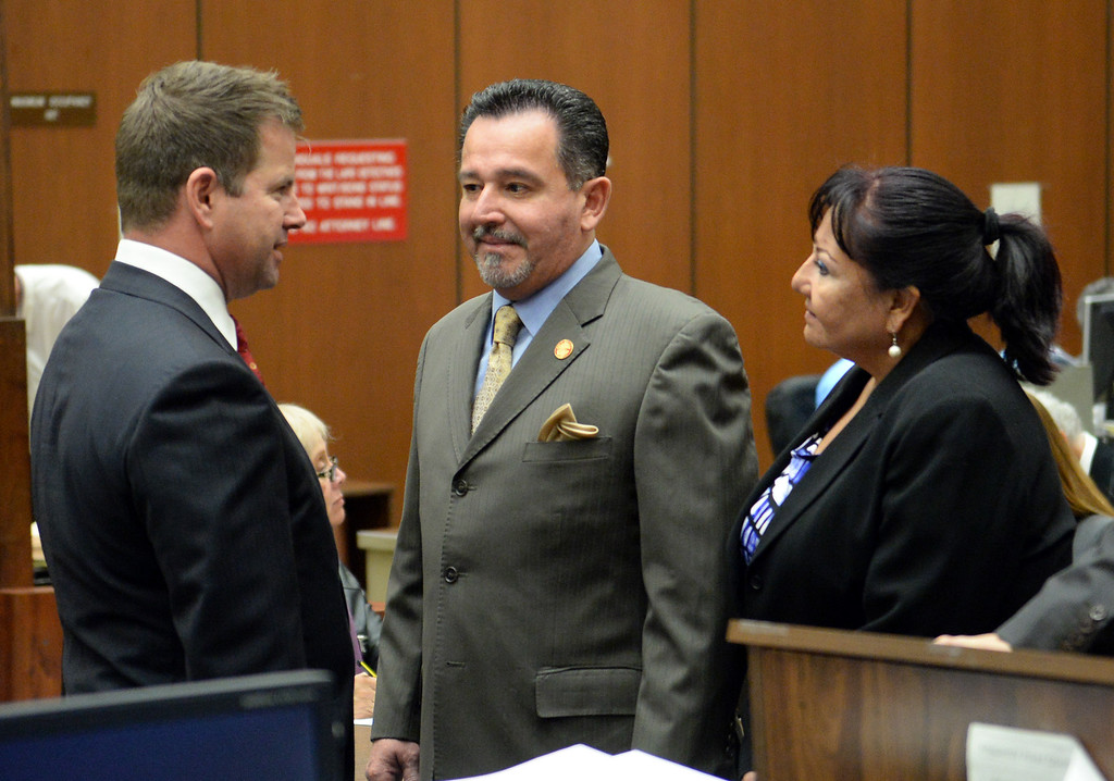 Description of . Irwindale City Councilman Mark Breceda, center, and former City Councilwoman Rosemary Ramirez who have been charged with embezzlement, misappropriation of public funds and conflict of interest, talk with attorney Anthony Falangetti, left, as they appear in court to postpone their arraignment at the Clara Shortridge Foltz Criminal Justice Center in Los Angeles on Wednesday January 29, 2014. They will next appear on February 27th. (Staff Photo by Keith Durflinger/San Gabriel Valley Tribune)