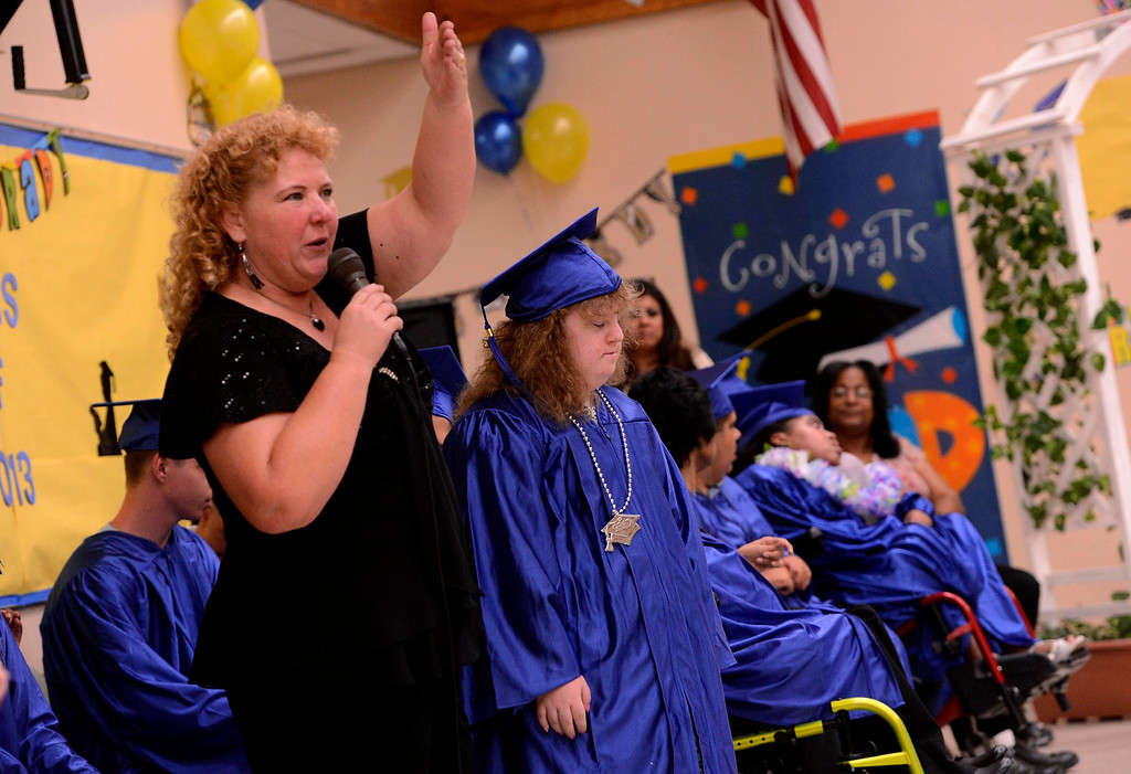 Description of . Instructor Julie Chesney speaks about her student Anastasia Shreve during Commencement Ceremonies at Carl And Dora Anderson School in San Bernardino May 21, 2013.  GABRIEL LUIS ACOSTA/STAFF PHOTOGRAPHER.