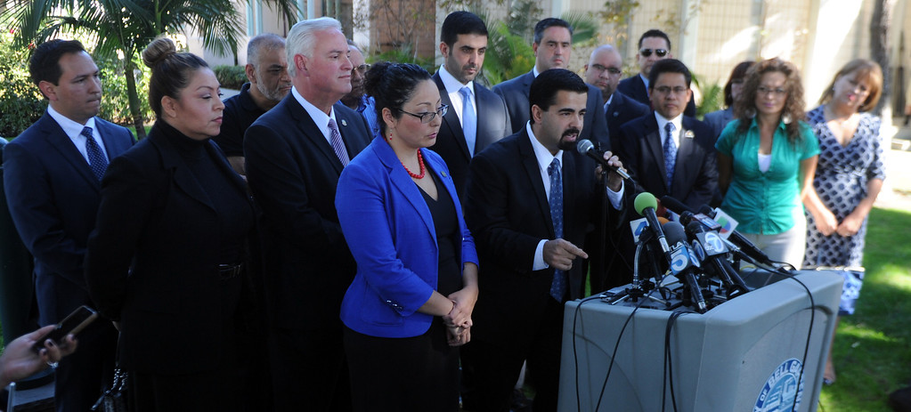 Description of . City of Bell Gardens mayor Daniel Crespo, center, speaks during a press conference with concerned regional elected officials calling for Senator Ron Calderon to resign his position in the California State Senate in front of the Bell Gardens City Hall in Bell Gardens , Calif., on Wednesday, Nov. 13, 2013.   (Keith Birmingham Pasadena Star-News)