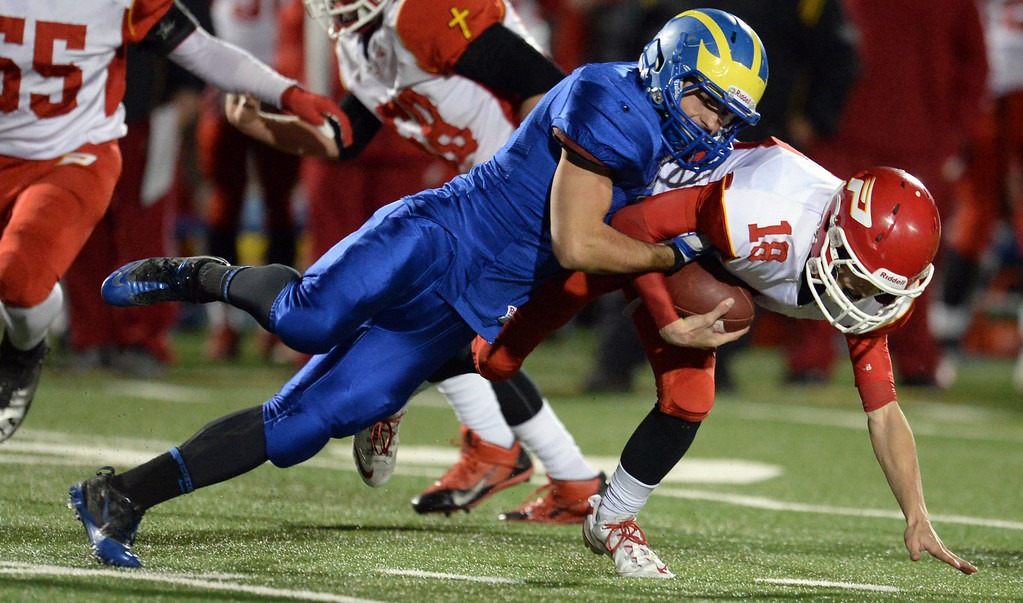Description of . San Dimas' Mitchell Giles (2) sacks Paraclete quarterback Brett Nelson (18) in the first half of a CIF-SS Mid-Valley Division championship football game at San Dimas High School in San Dimas, Calif., on Friday, Dec. 6, 2013.   (Keith Birmingham Pasadena Star-News)