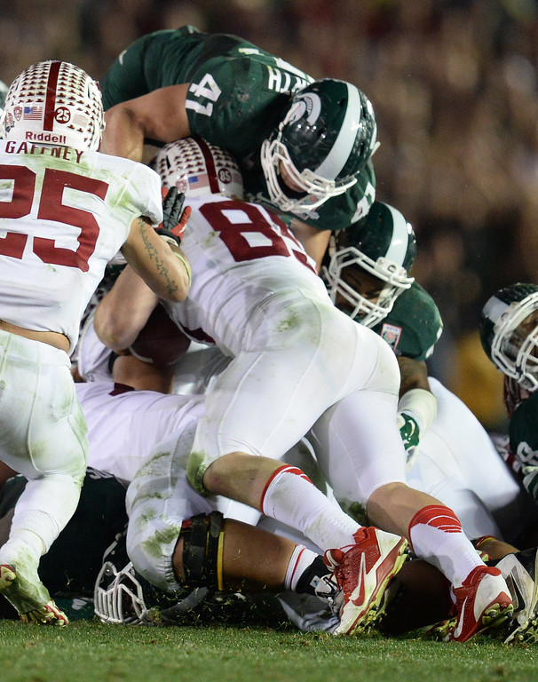 Description of . Michigan State's Kyler Elsworth #41 goes over the top to stop Stanford's Ryan Hewitt #85 on 4th and 1 late in the 4th quarter during the 100th Rose Bowl game in Pasadena Wednesday, January 1, 2014. Michigan State defeated Stanford 24-20. (Photo by Hans Gutknecht/Los Angeles Daily News)