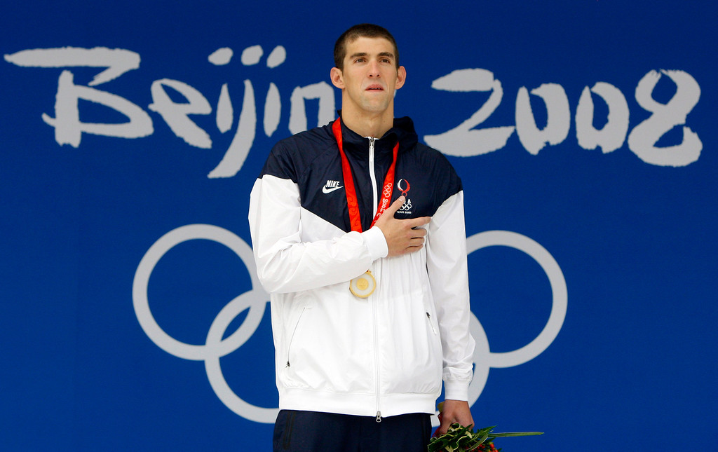 Description of . United States Michael Phelps celebrates his gold medal in the men\'s 200m individual medley final during the swimming competitions in the National Aquatics Center at the Beijing 2008 Olympics in Beijing, Friday, Aug. 15, 2008. (AP Photo/Mark Baker)