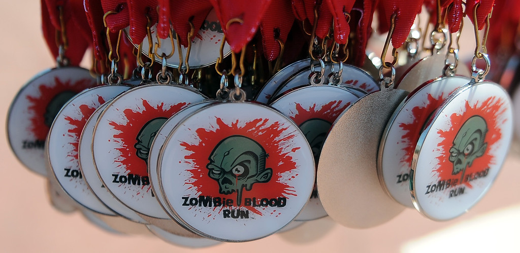 Description of . Zombie medals during the Zombie Blood Run at Santa Anita Park on Saturday, Aug. 17, 2013 in Arcadia, Calif. The American Red Cross San Gabriel Pomona Valley chapter is partnering with the Zombie Blood Run to prepare the San Gabriel Valley for a disaster, even a zombie apocalypse.  (Keith Birmingham/Pasadena Star-News)