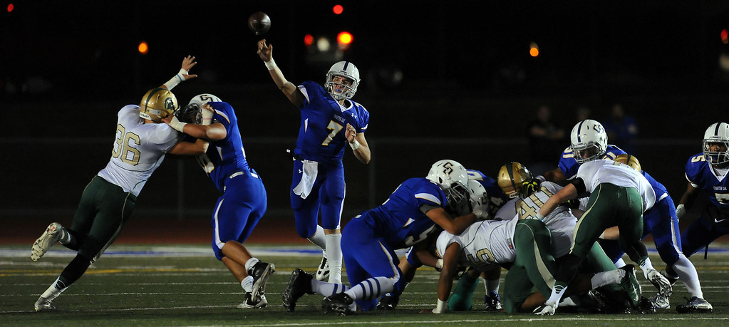 Description of . Charter Oak quarterback Kory Brown (7) passes in the first half of a prep football game against Damien at Charter Oak High School in Covina, Calif., Friday, Oct. 11, 2013.    (Keith Birmingham Pasadena Star-News)
