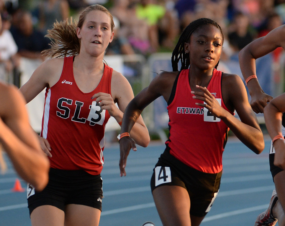 Description of . Etiwanda's Jacquelyn Hill, right, competes in the 800 meter race during the CIF California State Track & Field Championships at Veteran's Memorial Stadium on the campus of Buchanan High School in Clovis, Calif., on Saturday, June 7, 2014.   (Keith Birmingham/Pasadena Star-News)