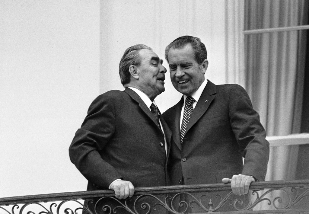 Description of . In this June 18,1973 file photo, Soviet leader Leonid I. Brezhnev, left, whispers in the ear of President Richard M. Nixon as the two leaders stand on a balcony at the White House in Washington. The meeting was the only summit ever recorded on an American presidential taping system. The last 340 hours of tapes from Nixon's White House were released Wednesday, Aug. 21, 2013, along with more than 140,000 pages of text materials. (AP Photo/File)