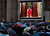 People watch on a video monitor in St. Peter's Square as Monsignor Guido Marini, master of liturgical ceremonies, closes the double doors to the Sistine Chapel in Vatican City Tuesday, March 12, 2013, at the start of the conclave of cardinals to elect the next pope. Marini closed the doors after shouting 
