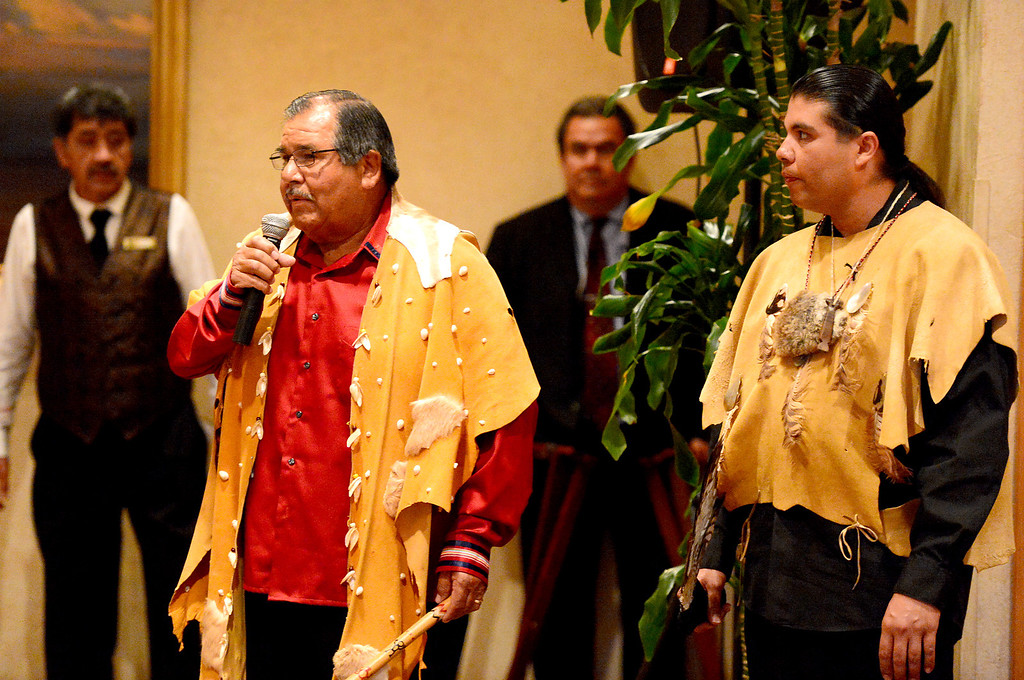 Description of . Anthony Morales and his son Andrew Morales, of the Gabrieleno Tongva, attend and bless the San Gabriel's Centennial Dinner April 24, 2013. Gabrielenos have been trying for decades to have their tribe be recognized by the Federal Government causing strain amongst tribal members. They are not alone in their quest to receive federal benefits through a process that many say is an impossible bureaucracy. (SGVN/Staff Photo by Sarah Reingewirtz)