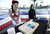 SAN PEDRO, CALIF. USA -- Pin-up girl Jamie Beman with a cake during the 70th. birthday celebration of the USS Iowa in San Pedro, Calif. on February 17, 2013.