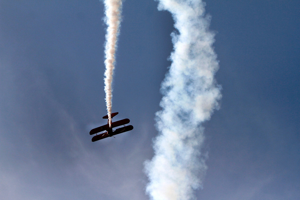 Description of . Pilot Vicky Benzing performs an aerobatic show in a Boeing Stearman during the Hangar 24 AirFest and 6th Anniversary Celebration on Friday, May 16, 2014 at the Redlands Municipal Airport in Redlands, Ca. (Photo by Micah Escamilla/Redlands Daily Facts)