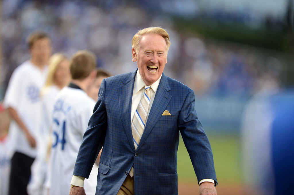 Description of . Vin Scully is all smiles during Vin Scully Bobblehead Night at Dodger Stadium in Los Angeles Thursday, August 30, 2012. (Hans Gutknecht/L.A. Daily News)