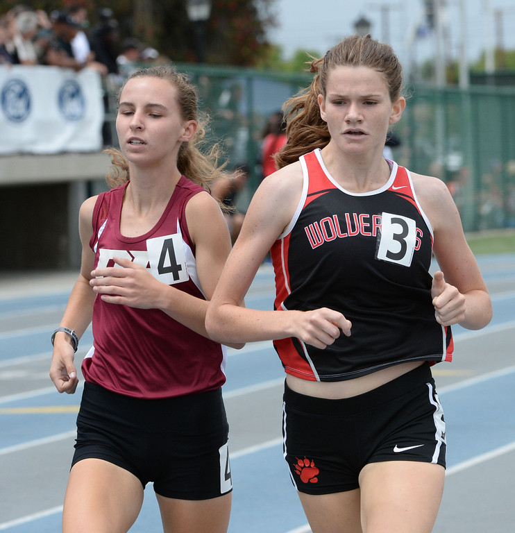 Description of . Harvard Westlake's Lizzy Thomas competes in the division 3 1600 meter race during the CIF Southern Section track and final Championships at Cerritos College in Norwalk, Calif., Saturday, May 24, 2014. 