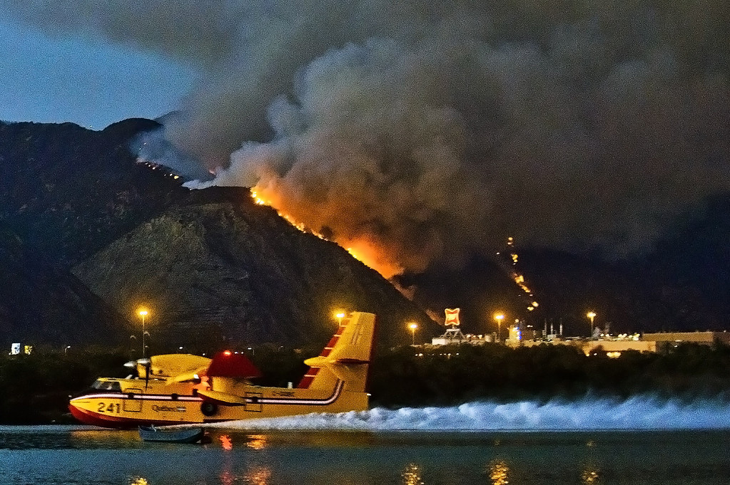 Description of . A Super Scooper air tanker makes a stop to refill at Santa Fe Dam Recreational Area in Irwindale while battling the Madre Fire in the Angeles National Forest above Azusa, Calif. that has burned about 50 acres on Monday evening, Sept. 23, 2013. (Photo by Watchara Phomicinda/ San Gabriel Valley Tribune)