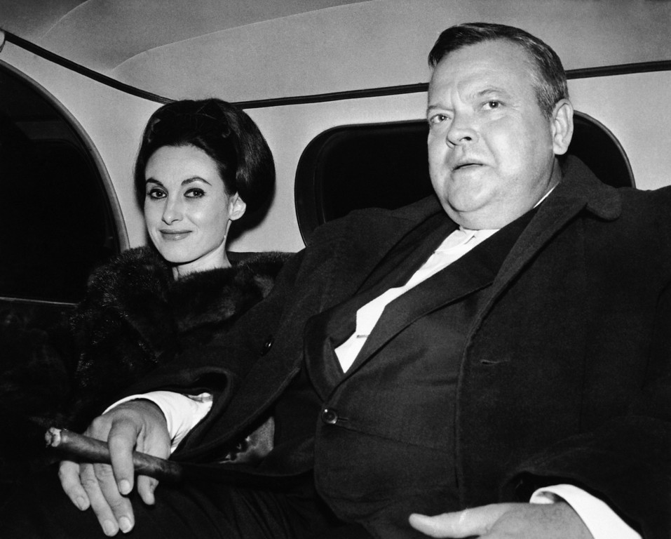"""Description of . American Actor Orson Welles and his wife Paola Mori, ride car as they leave their London Hotel, Oct. 29, 1963, twenty-five years after his famous dramatization of """"The War of the Worlds"""" the Broadcast, adapted from H.G. Wells Novel, was aired in October 1938 and caused a mass scare in the U.S. (AP Photo)"""