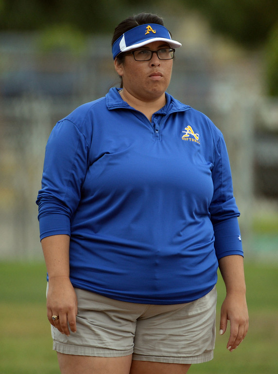 Description of . Bishop Amat head coach Kristen Dedmon in the third inning of a prep playoff softball game against La Serna at Bishop Amat High School in La Puente, Calif., on Thursday, May 22, 2014. La Serna won 6-0.   (Keith Birmingham/Pasadena Star-News)