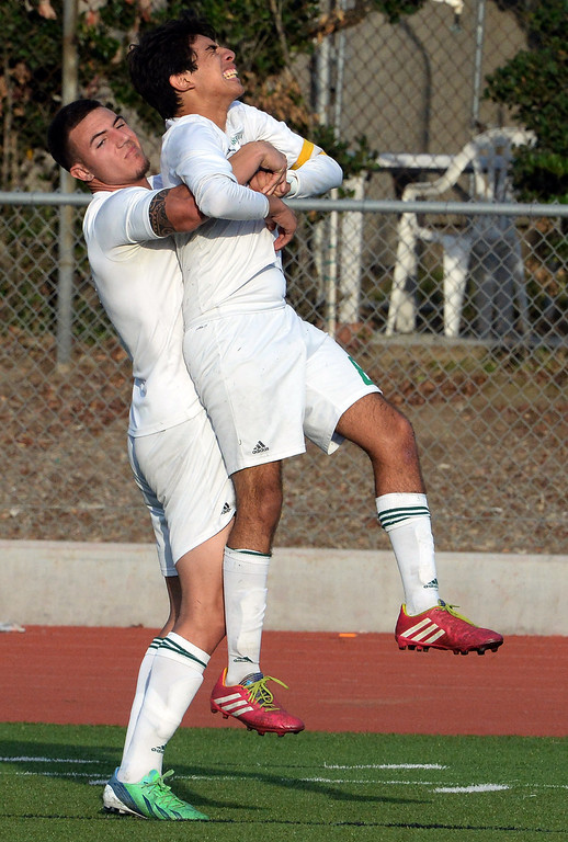 Description of . Monrovia's Danny Hoefferle, left, helps teammate Alfredo Maciel (C) (08) off the field with a leg cramp during a second round soccer match against Diamond Bar at Monrovia High School in Monrovia, Calif., on Tuesday, Feb.25, 2014. Diamond Bar won 3-2 on penalty kicks.