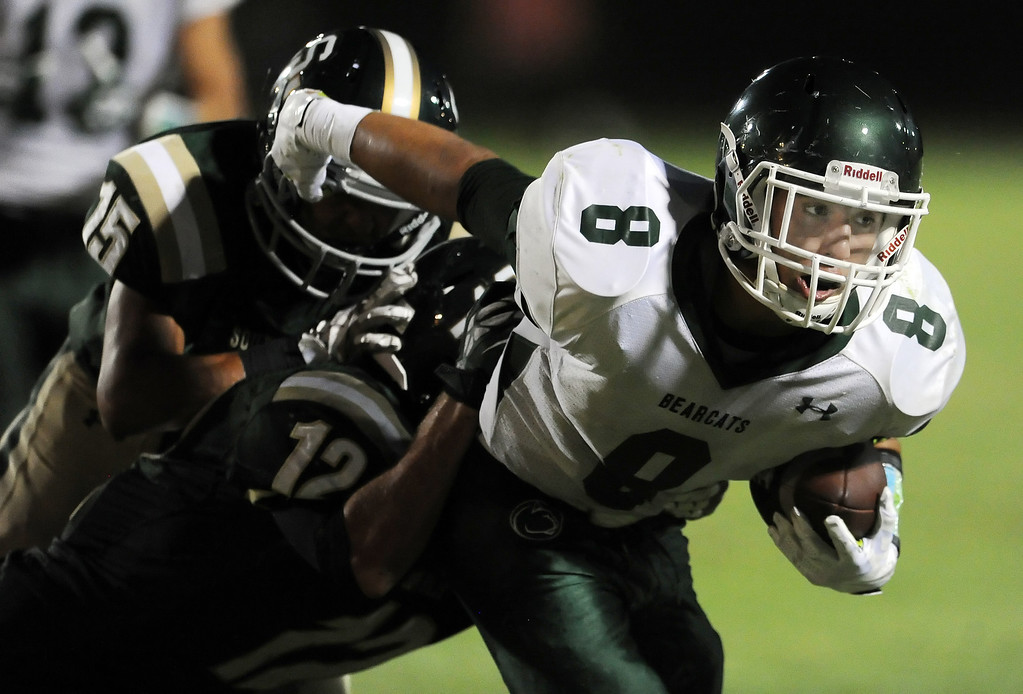 Description of . Bonita's Christian Ramos runs for a first down past South Hills' Carlos Delgado (15) and Adam Goss (12) in the first half of a prep football game at Covina District Field in Covina, Calif. on Friday, Sept. 6, 2013.   (Photo by Keith Birmingham/Pasadena Star-News)