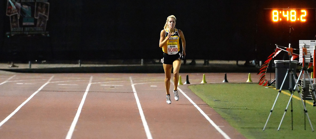 Description of . Laguna Hills' Brianna Bartello competes in the 4x1600 Meter relay Seeded during the Arcadia Invitational track and field meet at Arcadia High School in Arcadia, Calif., on Friday, April 11, 2014.  (Keith Birmingham Pasadena Star-News)