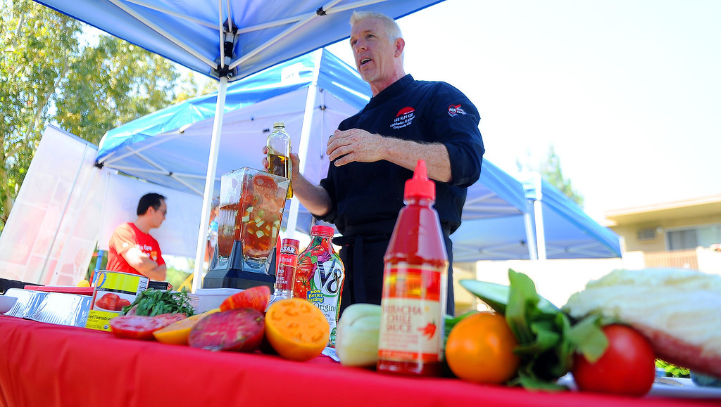 Description of . Lee Kum Kee, corporate chef Christopher Wilmoth held a cooking demo where he prepared grilled salmon, mango salsa along with fresh summer gaspacho at the Palms affordable housing community, Project Access Resource Center on Wednesday, July 31, 2013 in Rowland Heights, Calif.   (Keith Birmingham/Pasadena Star-News)