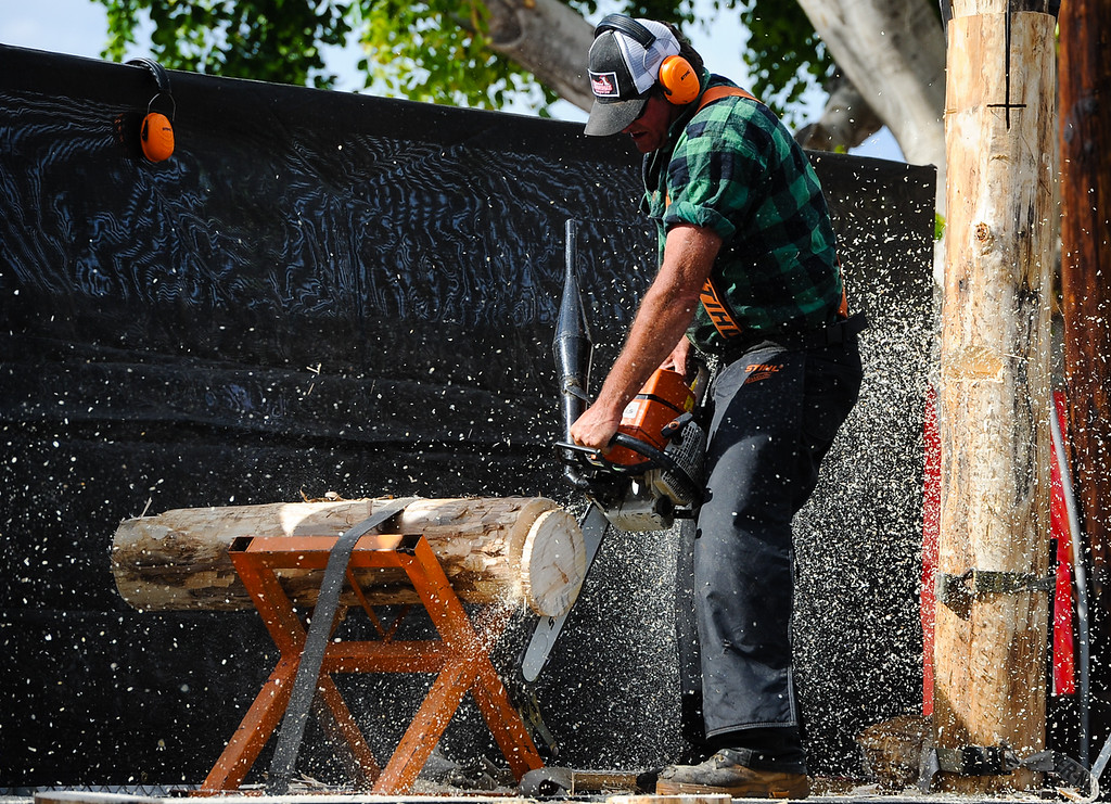 Description of . Chainsaw carving demonstrations entertain fair-goers at the 91st annual Los Angeles County Fair in Pomona on Sept. 2, 2013. The fair will run through September 29. (Rachel Luna / San Bernardino Sun)