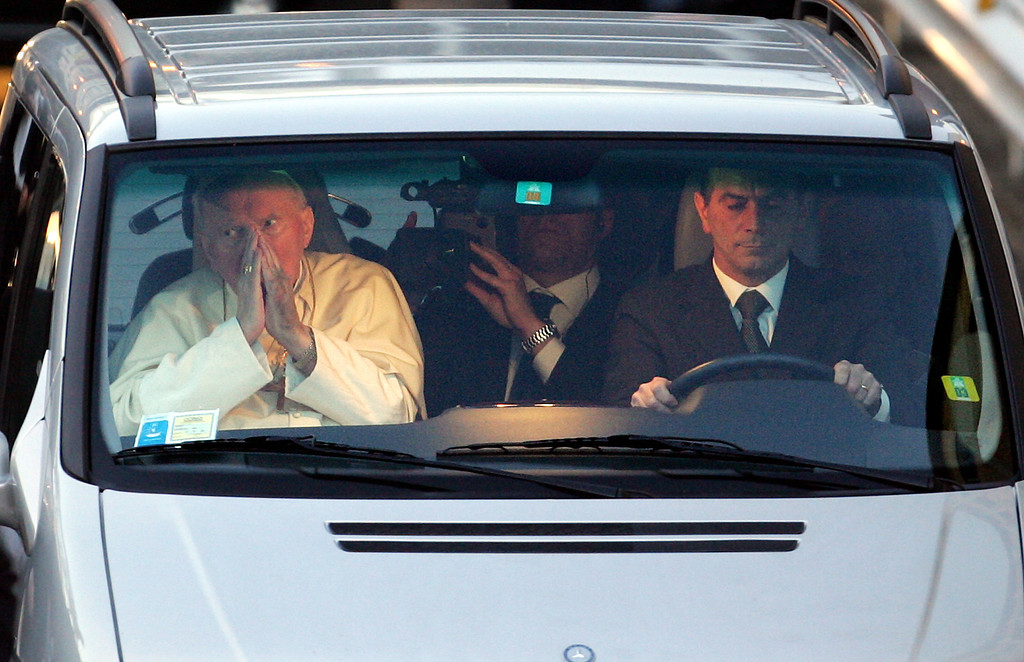 Description of . Pope John Paul II leaves Rome's Gemelli Polyclinic hospital where he was hospitalized, Sunday, March 13, 2005. The pope left the hospital weeks after  suffering another breathing crisis and hours after greeting pilgrims in a voice  that was raspy but raised hopes among Roman Catholics that he would recover. (AP Photo/Andrew Medichini)