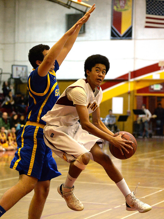 Description of . Wilson's Kyle Price drives to the basket against San Dimas in the first half of a prep basketball game at Wilson High School in Hacienda Heights, Calif., on Friday, Jan. 31, 2014. (Keith Birmingham Pasadena Star-News)