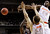 Syracuse forward Rakeem Christmas (25) blocks a shot by Montana guard Will Cherry, bottom, as Syracuse's Brandon Triche (20) defends during the first half of a second-round game in the NCAA college basketball tournament in San Jose, Calif., Thursday, March 21, 2013. (AP Photo/Jeff Chiu)