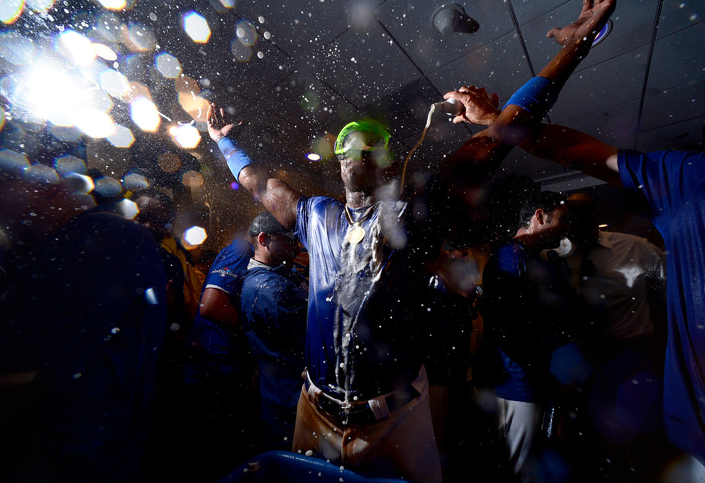 Description of . The Los Angeles Dodgers' Yasiel Puig celebrates winning the NLDS title with his team in Dodger Stadium's club house Monday night, October 7, 2013. Dodgers defeated the Atlanta Braves 4-3 in the fourth game. (Photo by Sarah Reingewirtz/Los Angeles Daily News)