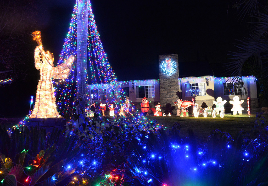 Description of . Holiday lights on display at one of three houses on the 8200-block of La Bajada Ave. in Whittier on Friday December 20, 2013. (Staff Photo by Keith Durflinger/Whittier Daily News)