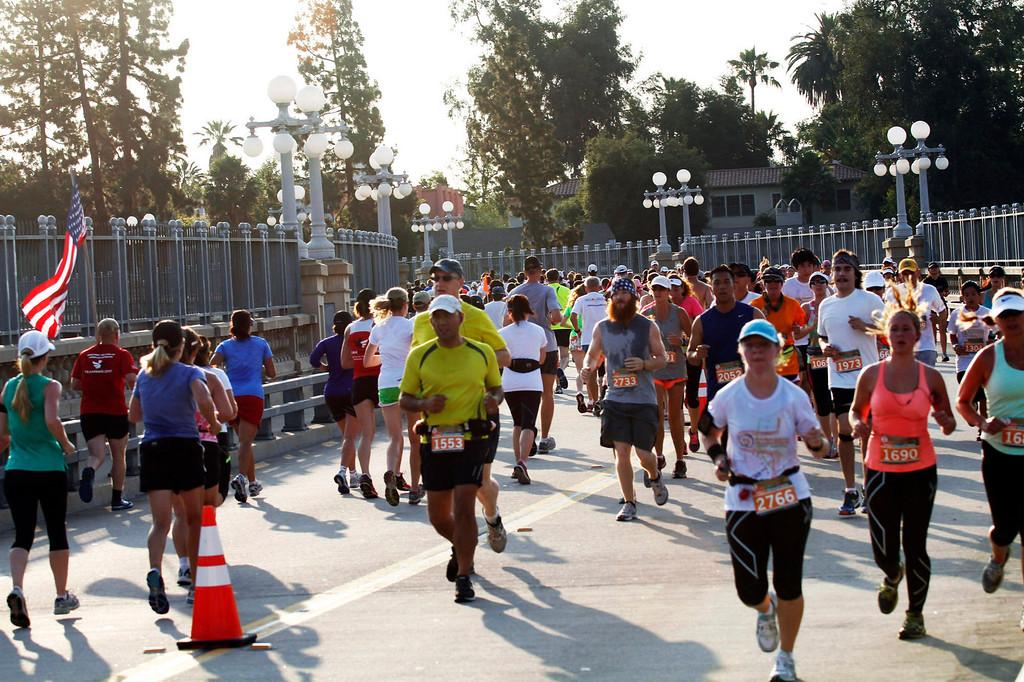Description of . Participants run over Pasadena's Colorado Street Bridge, during the 5th Annual Pasadena Marathon Event, in Pasadena, Sunday, June 30, 2013. (SXCITY/Correspondent Photo by James Carbone)