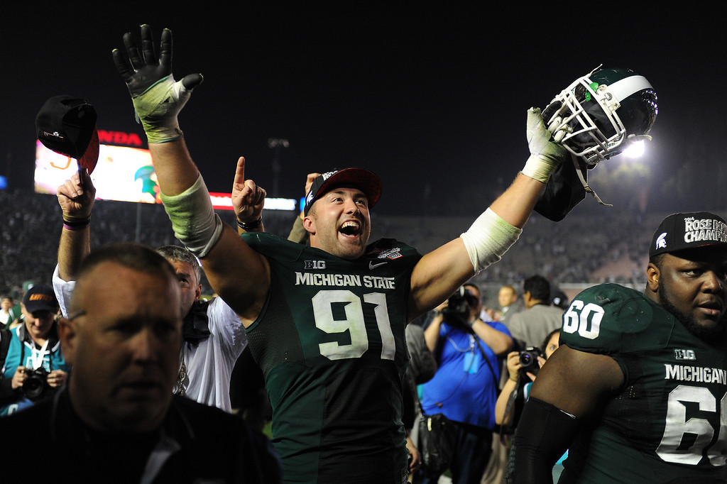 Description of . Michigan State's Tyler Hoover celebrates after beating Stanford 24-20 at the Rose Bowl, Wednesday, January 1, 2014. (Photo by Michael Owen Baker/L.A. Daily News)
