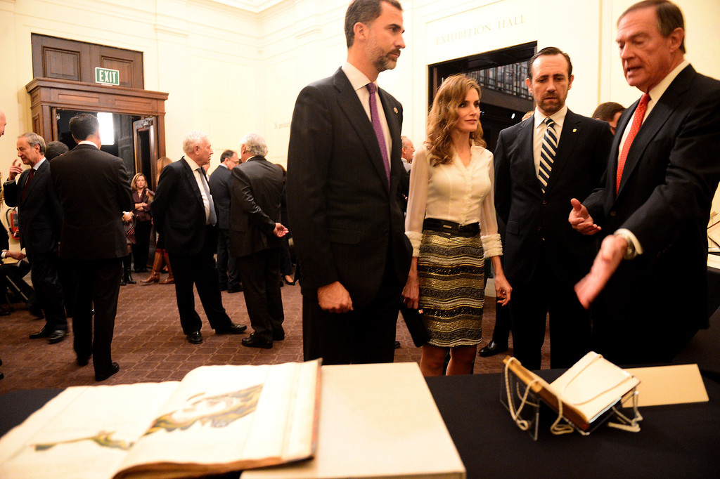 Description of . The Crown Prince Felipe and Princess Letizia of Spain, left, are shown Spanish documents documents in The Huntington Library's Exhibition Hall as they visit the Junipero Serra exhibition in San Marino Saturday night, November 16, 2013. (Photo by Sarah Reingewirtz/Pasadena Star-News)