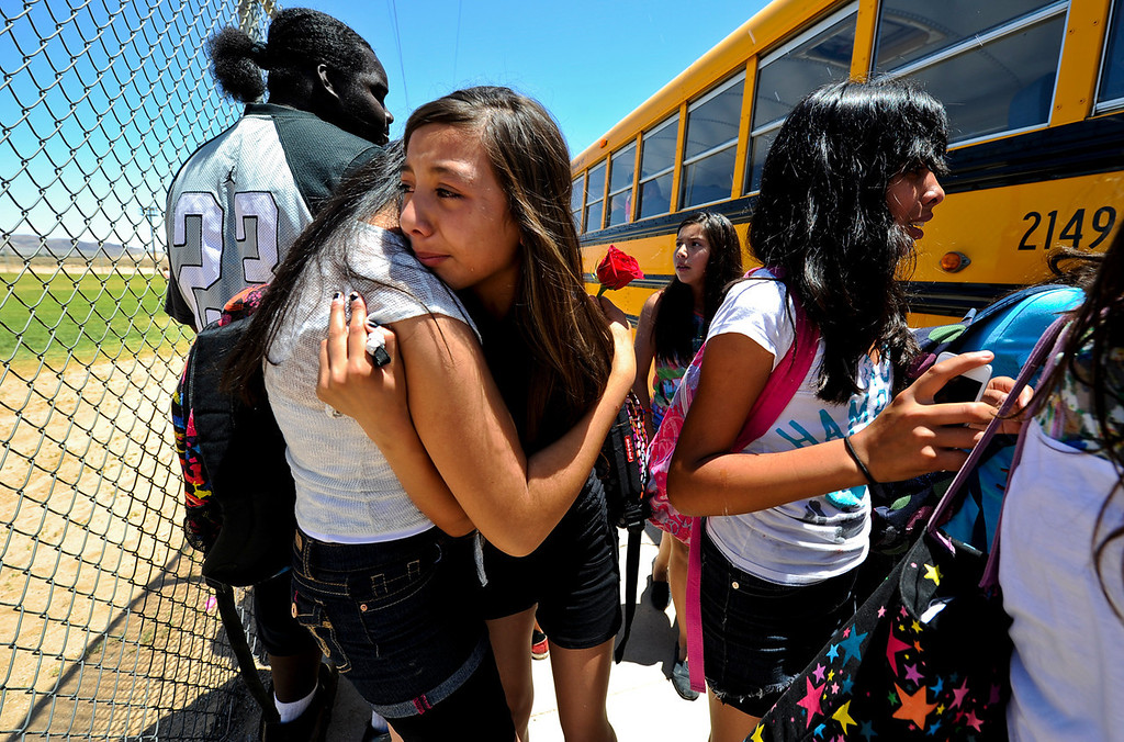 Description of . Hinkley student Brianna Varga cries as she says her final goodbye to a friend on the final day of school at Hinkley School in Hinkley, Calif. on Thursday, June 6, 2013. Hinkley School closed its doors for good at the end of the 2012-2013 school year. (Rachel Luna / San Bernardino Sun)