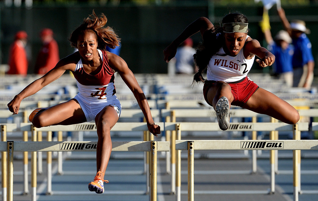 Description of . Alemany's Skylin Harbin, left, and Long beach Wilson's Elijah McDonald competes in the 100 meter hurdles during the CIF-SS Masters Track and Field meet at Falcon Field on the campus of Cerritos College in Norwalk, Calif., on Friday, May 30, 2014.   (Keith Birmingham/Pasadena Star-News)