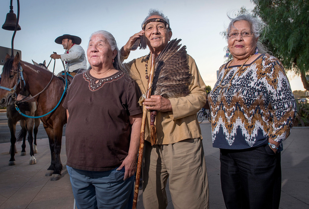 Description of . Ernie Salas, chief of the Gabrieleño Band of Mission Indians/Kizh Nation,  greets the seven horseback enthusiasts at Mission San Gabriel as part of The California Mission Ride flanked by his sisters Jenny Swindall, left, and Lorraine Nava October 8, 2013.   (Staff photo by Leo Jarzomb/Pasadena Star-News)