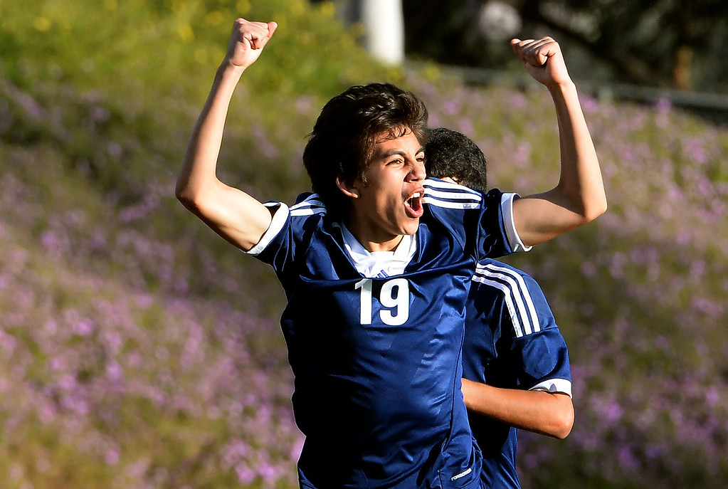 Description of . Baldwin Park's Cesar Medina reacts after scoring the game winning goal in the second half of a CIF-SS quarterfinal prep playoff soccer match against Diamond Bar at Diamond Bar High School in Diamond Bar, Calif., on Thursday, Feb.27, 2014. Baldwin Park won 2-1. (Keith Birmingham Pasadena Star-News)