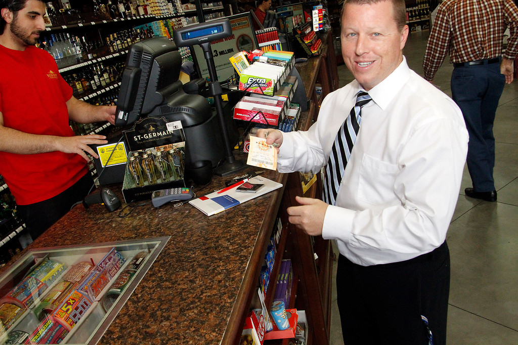 Description of . Rob McCormick, of Pasadena, buys a Powerball ticket, a jackpot worth $600 milion, at Mission Liquor Store in Pasadena, Friday, May 17, 2013. (Correspondent Photo by James Carbone/SXCITY)