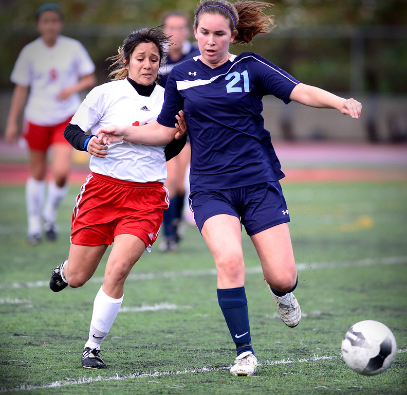 Description of . Sierra Vista's Maria Hernandez (14) and Camarillo's Jackie Fiacco (21) struggle for the ball as Camarillo defeats Sierra Vista 3-1 in a quarterfinal game at Sierra Vista High School in Baldwin Park, February 28, 2014. (Photo by Sarah Reingewirtz/Pasadena Star-News)