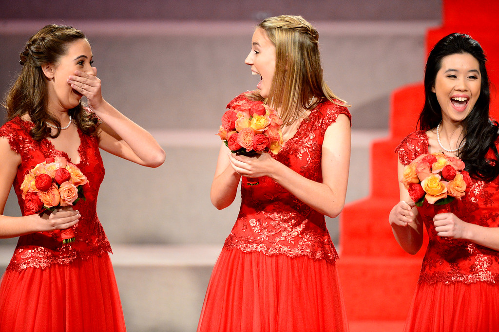 Description of . Ana Acosta, left, reacts as she is named the 96th Rose Queen during the Tournament of Roses' coronation ceremony Thursday night, October 24, 2013 at the First Church of the Nazarene of Pasadena. Princesses Katherine Lipp and Elyssia Widjaja are right. (Photo by Sarah Reingewirtz/Pasadena Star-News)