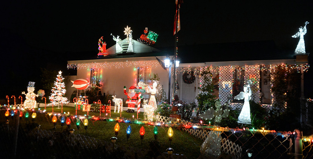 Description of . A home is decorated with holiday lights along Groverdale St. and Lark Ellen in Covina, Calif., on Thursday, Dec. 19, 2013.     (Keith Birmingham Pasadena Star-News)