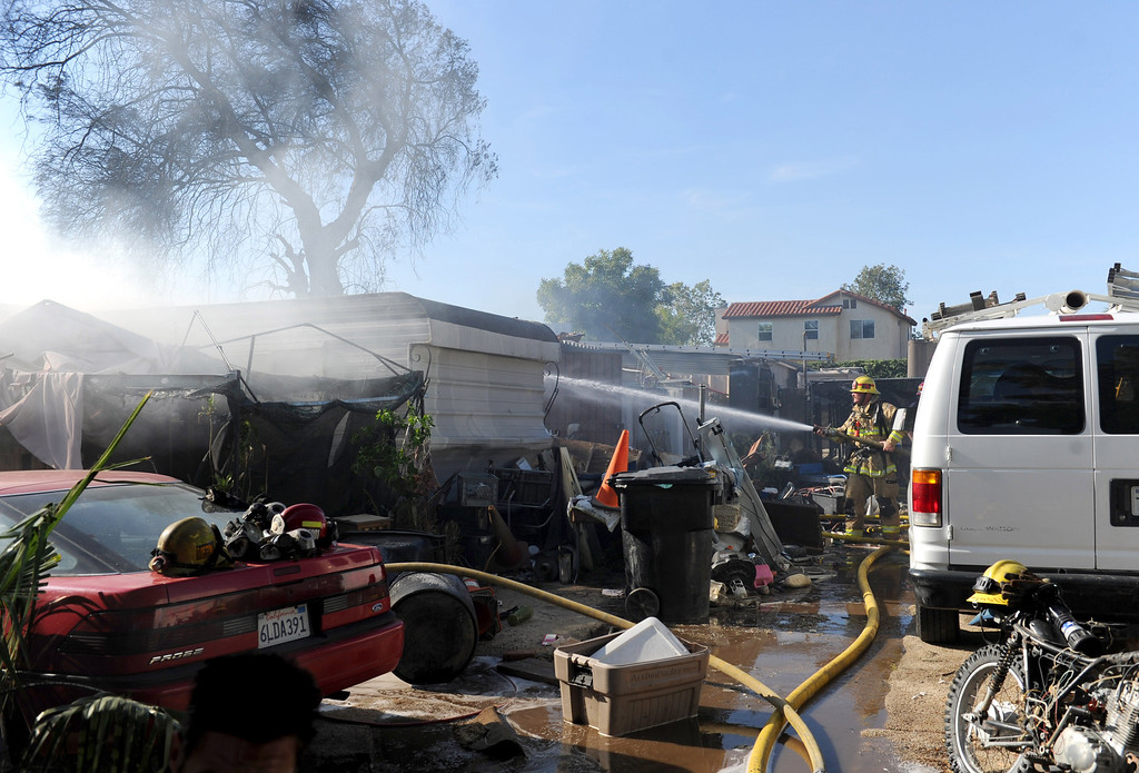 Description of . San Bernardino County Firefighters respond to a three alarm fire in the 18000 block of Bloomington,Ca., Tuesday April 29, 2014 . (Photo by John Valenzuela/The Sun)