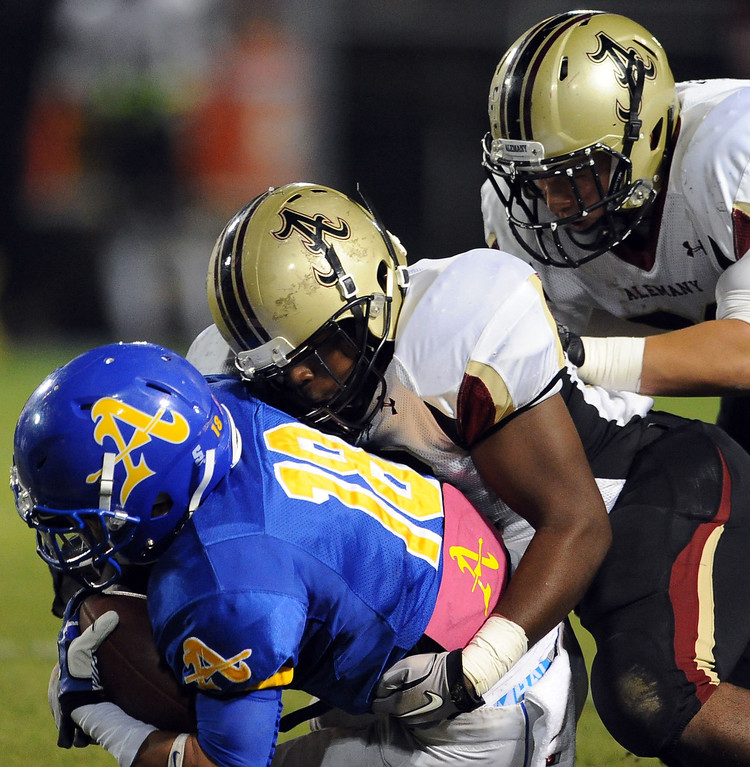 Description of . Bishop Amat's Trevon Sidney (18) catches a pas for a first down as the Alemany defense makes the tackle in the first half of a prep football game at Bishop Amat High School in La Puente, Calif., on Friday, Oct. 25, 2013.    (Keith Birmingham Pasadena Star-News)